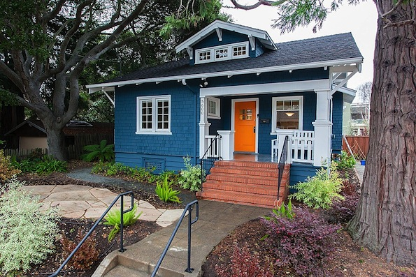 blue craftsman house with orange door