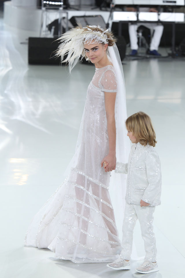 PARIS, FRANCE - JANUARY 21:  Cara Delevingne walks the runway during the Chanel show as part of Paris Fashion Week Haute-Couture Spring/Summer 2014 on January 21, 2014 in Paris, France.  (Photo by Antonio de Moraes Barros Filho/WireImage)