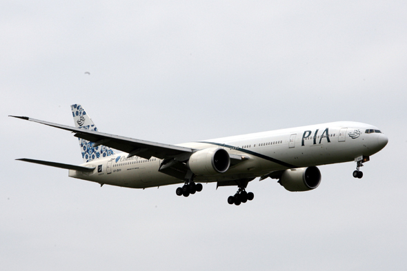 A PIA Boeing 777 plane lands at Heathrow Airport in Middlesex