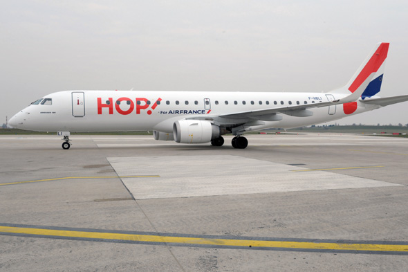 An Air France regional airline subsidiary Hop! Embraer 190 plane stands on the tarmac during the presentation of the aircraft of the new company at Paris-Orly airport on March 26, 2013. AFP PHOTO/  ERIC PIERMONT        (Photo credit should read ERIC PIERMONT/AFP/Getty Images)