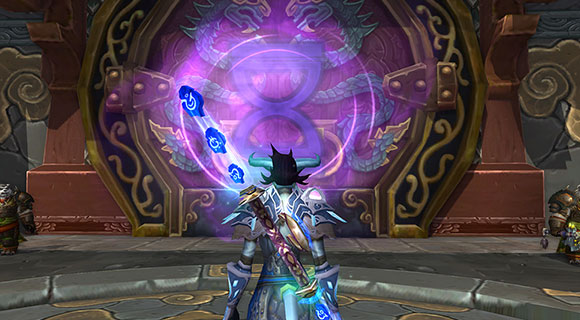 A draenei mage stands in front of the entrance to a Challenge Mode.