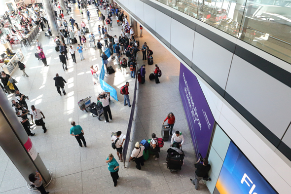 A general view of arrivals in Terminal 5 at Heathrow Airport, London.