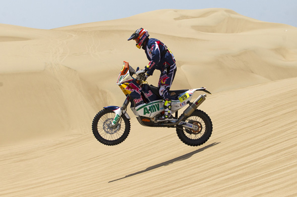 KTM rider Kurt Caselli of the U.S. competes in the 1st stage of the 2013 Dakar Rally near Pisco, Peru, Saturday, Jan. 5, 2013. The race finishes in Santiago, Chile, on Jan. 20. (AP Photo/Victor R. Caivano)