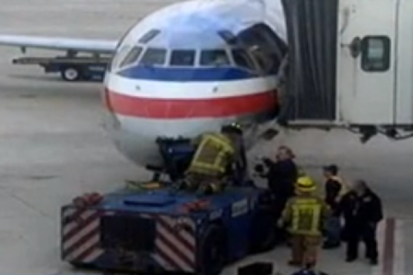 American-airlines-flight-delayed-tow-truck-crashes-into-plane
