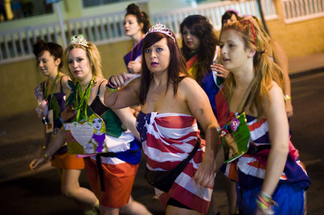SALOU, SPAIN - APRIL 01:  British students in fancy dress are seen during the first night of parties during the SalouFest on April 1, 2012 in Salou, Spain. Saloufest is a sporting tour event where thousands of British university students take part in different sport competitons and join parties during the eastern holidays in the catalan village of Salou. (Photo by David Ramos/Getty Images)