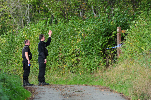 Police at the scene at Sweeney mountain near Oswestry in Shropshire, as they investigate the discovery of bones in the location.