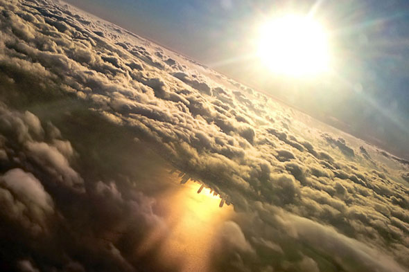 Chicago taken from a plane window shows the city beautifully reflected in Lake Michigan