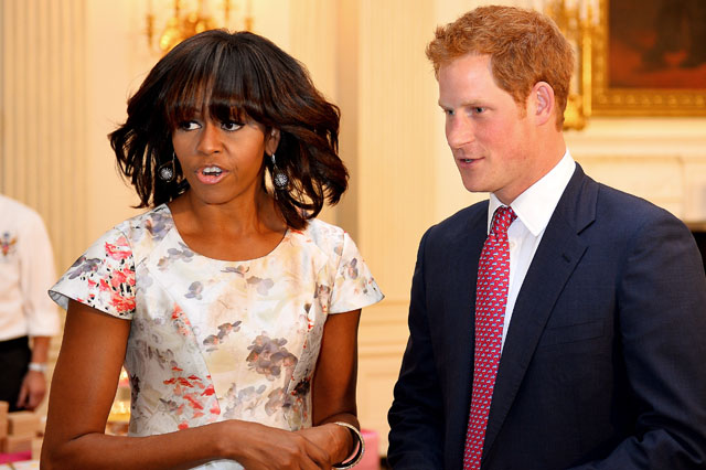 WASHINGTON, DC - MAY 09:  HRH Prince Harry speaks with First Lady Michelle Obama during the first day of his visit to the United States on May 9, 2013 in Washington, DC. HRH will be undertaking engagements on behalf of charities with which the Prince is closely associated on behalf also of HM Government, with a central theme of supporting injured service personnel from the UK and US forces. (Photo by John Stillwell - WPA Pool/Getty Images)