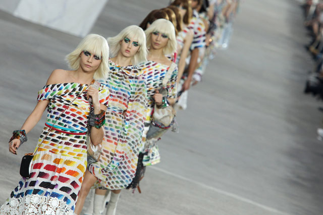 PARIS, FRANCE - OCTOBER 01: Cara Delevingne leads models down the runway during Chanel show as part of the Paris Fashion Week Womenswear Spring/Summer 2014 on October 1, 2013 in Paris, France. (Photo by Antonio de Moraes Barros Filho/WireImage)
