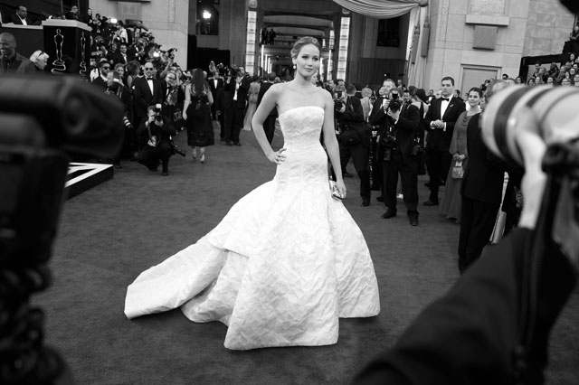 BLACK AND WHITE VERSION Best Actress nominee Jennifer Lawrence arrives on the red carpet for the 85th Annual Academy Awards on February 24, 2013 in Hollywood, California. AFP PHOTO/JOE KLAMAR        (Photo credit should read JOE KLAMAR/AFP/Getty Images)