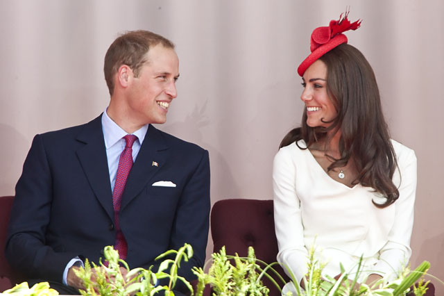 Catherine, Duchess of Cambridge, speaks to her husband Prince William as the couple take part in Canada Day celebrations on Parliament Hill in Ottawa on July 1, 2011. The Duke and Duchess are on a nine-day tour of Canada, their first official foreign trip as husband and wife.        AFP PHOTO/GEOFF ROBINS (Photo credit should read GEOFF ROBINS/AFP/Getty Images)