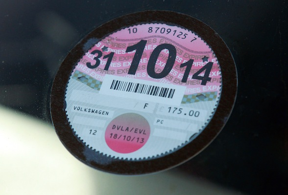 DETAILS OBSCURED BY PA PICTURE DESK A car tax disc. After more than 90 years affixed to British motorists' cars, the tax disc is to be scrapped and replaced with a modern electronic system, Chancellor George Osborne will announce today.