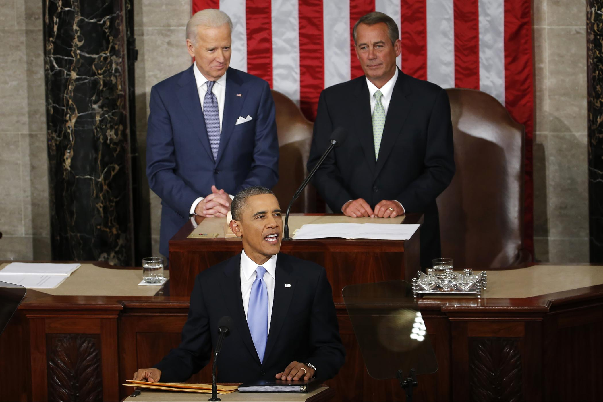 President Barack Obama takes the podium to give his State of the Union address on Capitol Hill in Washington, Tuesday Jan. 28, 2014. Vice President Joe Biden and House Speaker John Boehner of Ohio are behind the president. (AP Photo/Charles Dharapak)