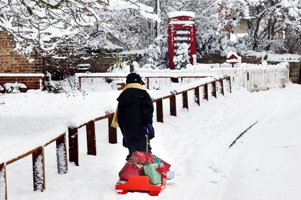 A young boy discovers the traditional way for delivering  presents this Christmas in Husthwaite near Easingwold, as further heavy snowfalls in the area made a white Christmas almost certain.   * With only two days to go to December 25, the PA WeatherCentre said there was a 90% chance of a white Christmas, with Scotland and northern England the most likely.
