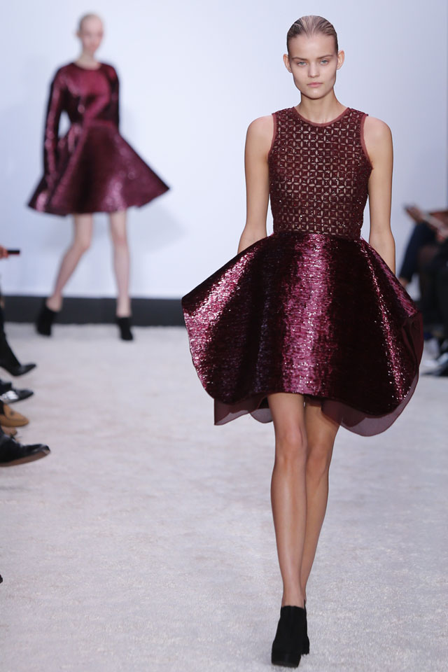 A model wears a creation for Giambattista Valli's ready-to-wear fall/winter 2014-2015 fashion collection presented in Paris, Monday, March 3, 2014. (AP Photo/Jacques Brinon)
