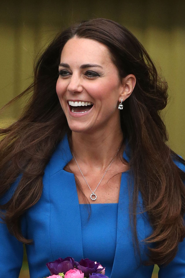 EALING, ENGLAND - FEBRUARY 14:  Catherine, Duchess of Cambridge jokes with staff as she leaves the opening of the ICAP Art Room at Northolt High School on February 14, 2014 in Ealing, England.  (Photo by Danny Martindale/WireImage)