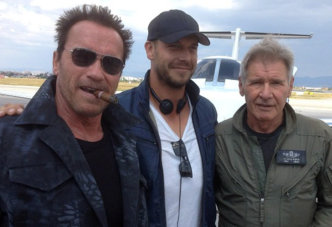 Arnold Schwarzenegger, Paul Hughes, and Harrison Ford on the 'Expendables 3' set