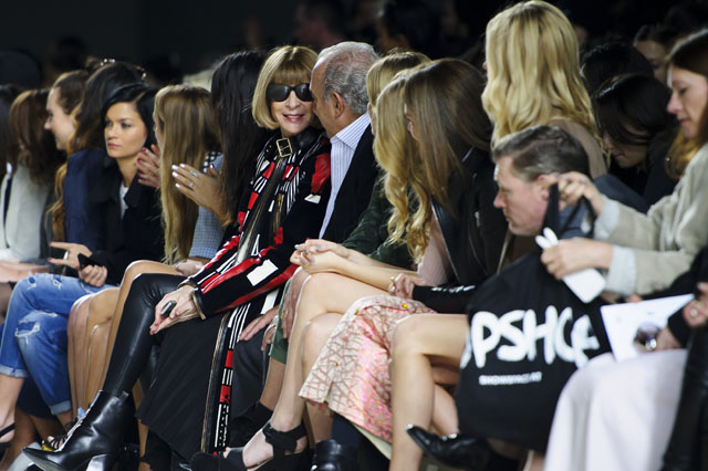 Centre, British Editor-in-chief of American Vogue Anna Wintour in the front row during the Topshop Unique collection at London Fashion Week Autumn/Winter 2014, at the Tate Modern in central London, Sunday, Feb. 16, 2014. (Photo by Jonathan Short/Invision/AP)