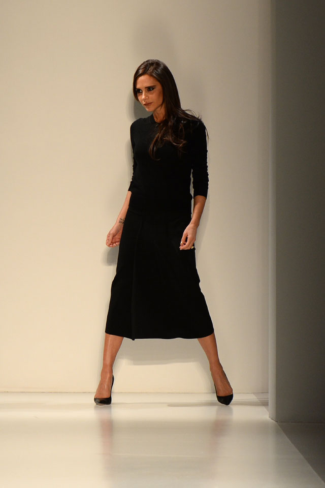 Victoria Beckham at the end of her show during the Mercedes-Benz Fashion Week Fall/Winter 2014 shows February 9, 2014 in New York City.  AFP PHOTO / Don EMMERT        (Photo credit should read DON EMMERT/AFP/Getty Images)
