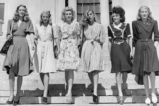 A group of six French women, out of which five are sporting dyed hair.