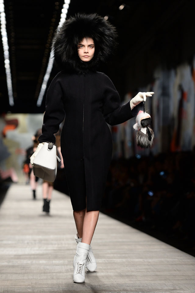 MILAN, ITALY - FEBRUARY 20:  A model Cara Delevingne walks the runway at the Gucci Show during Milan Fashion Week Womenswear Autumn/Winter 2014 on February 20, 2014 in Milan, Italy.  (Photo by Venturelli/WireImage)