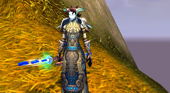 A draenei mage wielding the Apostle of Argus staff