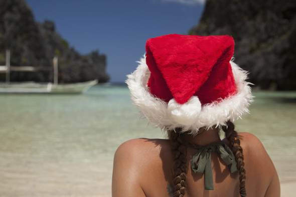Mandatory Credit: Photo by Design Pics Inc/REX (3335313a) Model Released - A Woman Tourist Wears A Santa Hat And Bikini On Tropical Matinloc Island Near El Nido And Corong Corong Bacuit Archipelago On Palawan Philippines VARIOUS