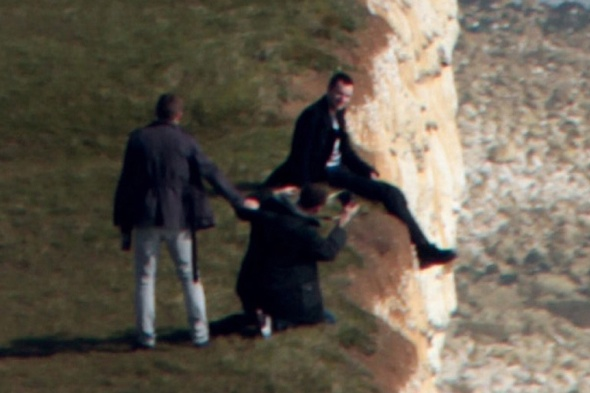 This is the shocking moment when a reckless man was spotted posing for a picture while dangling his legs over a crumbling 500ft cliff face.  Photographer Martin Stitchener, 40, said he was 'stunned' to see the man sitting perilously close to the edge of Britain's highest chalk cliffs.  The daredevil and a group of friends were taking it in turns to perch above the steep drop at the famous beauty spot Beachy Head, East Sussex.  SEE OUR COPY FOR DETAILS.  Pictured: The male sat on the side of the cliff with his legs dangling over.  This is the view of cliffs at Beachy Head.  © Martin Stitchener/Solent News & Photo Agency UK +44 (0) 2380 458800
