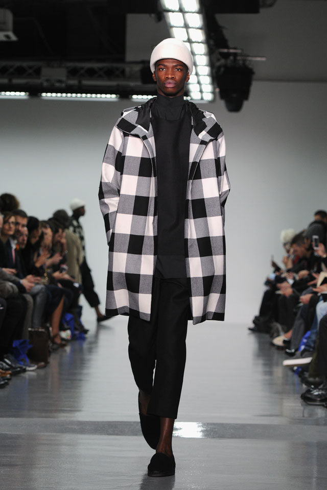 LONDON, ENGLAND - JANUARY 08:  A model walks the runway at the Agi & Sam show during The London Collections: Men Autumn/Winter 2014 on January 8, 2014 in London, England.  (Photo by Eamonn M. McCormack/Getty Images)