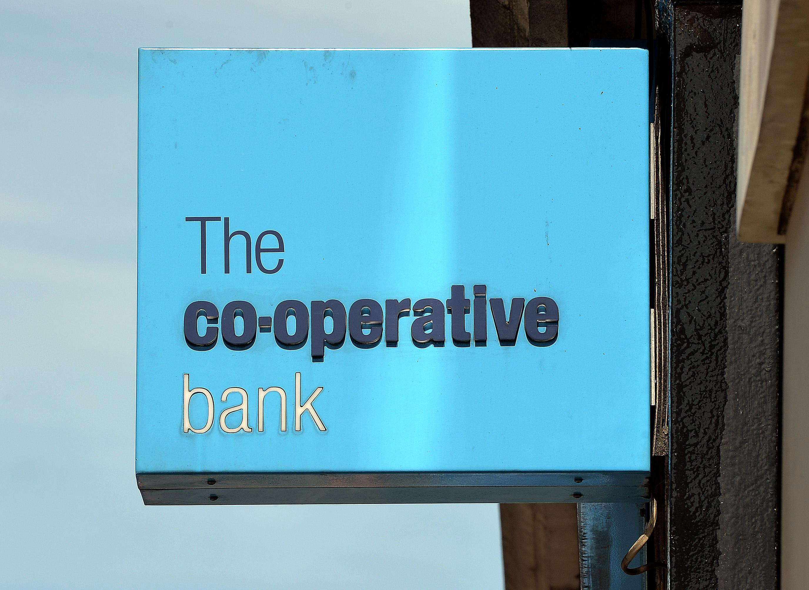 File photo dated 07/08/13 of a Co-operative Bank branch sign as the bank has launched a new fight to win back customers and re-build its ethical reputation with a ?125 current account switching offer which includes a donation to charity. PRESS ASSOCIATION Photo. Issue date: Tuesday February 4, 2014. Customers who switch their current account to the Co-op will get ?100 and they will also be able to donate a further ?25 to one of seven charities, including Action Aid, Oxfam, Water Aid and Amnesty International. See PA story MONEY Coop. Photo credit should read: John Stillwell/PA Wire