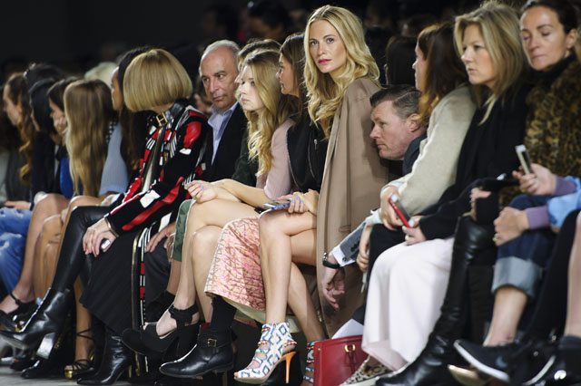 British model Poppy Delevingne, centre, in the front row during the Topshop Unique collection at London Fashion Week Autumn/Winter 2014, at the Tate Modern in central London, Sunday, Feb. 16, 2014. (Photo by Jonathan Short/Invision/AP)