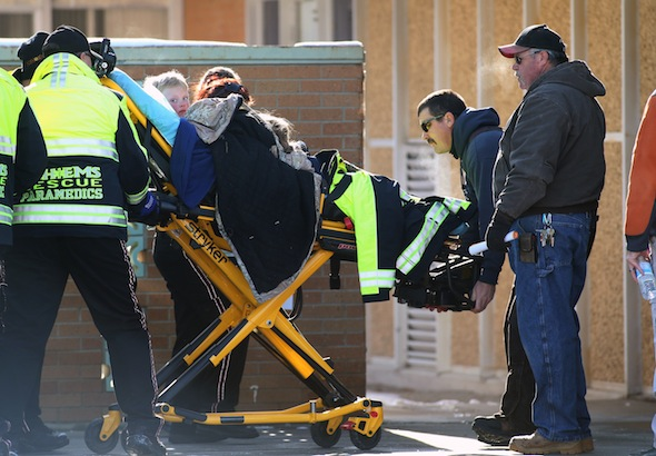 A group of six people arrive at Pershing General Hospital after being lost for two days in the frigid mountains near Lovelock, Nev., Tuesday, Dec. 10, 2013. (AP Photo/Cathleen Allison)