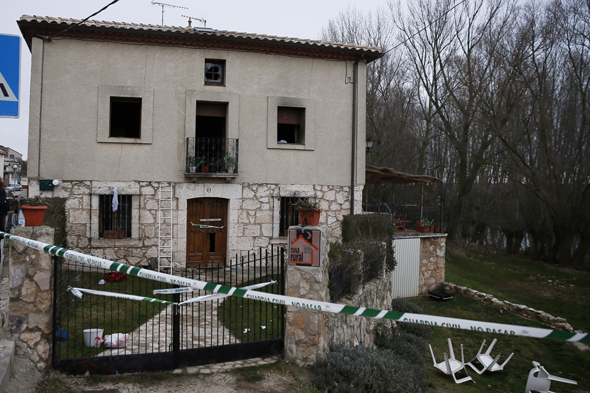 A facade of the burntout house where six people died in a house fire is seen in Tordomar, near Burgos on February 22, 2014. Three adults aged between 35 and 59 as well as three young boys aged four and six perished in the early morning blaze that also wounded five other occupants of the house at the cottage in the Ribera del Arlanza Tordomar where two others managed to escape the flames.        (Photo credit should read CESAR MANSO/AFP/Getty Images)