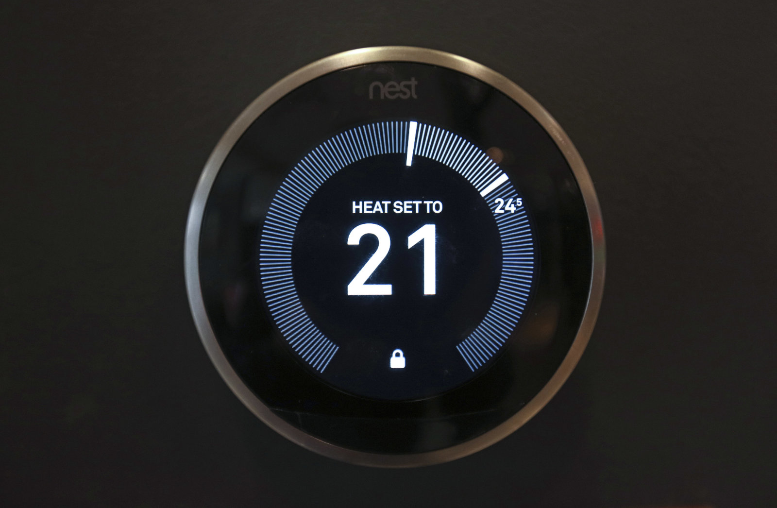 A Nest Labs Inc. digital wireless controlled thermostat sits on display in the Smart Home section of a John Lewis Plc department store in London, U.K., on Friday, April 8, 2016. The increasing integration of connected devices into our lives, what is commonly referred to as the Internet of things or IoT, promises enormous benefits for consumers and businesses. Photographer: Chris Ratcliffe/Bloomberg via Getty Images