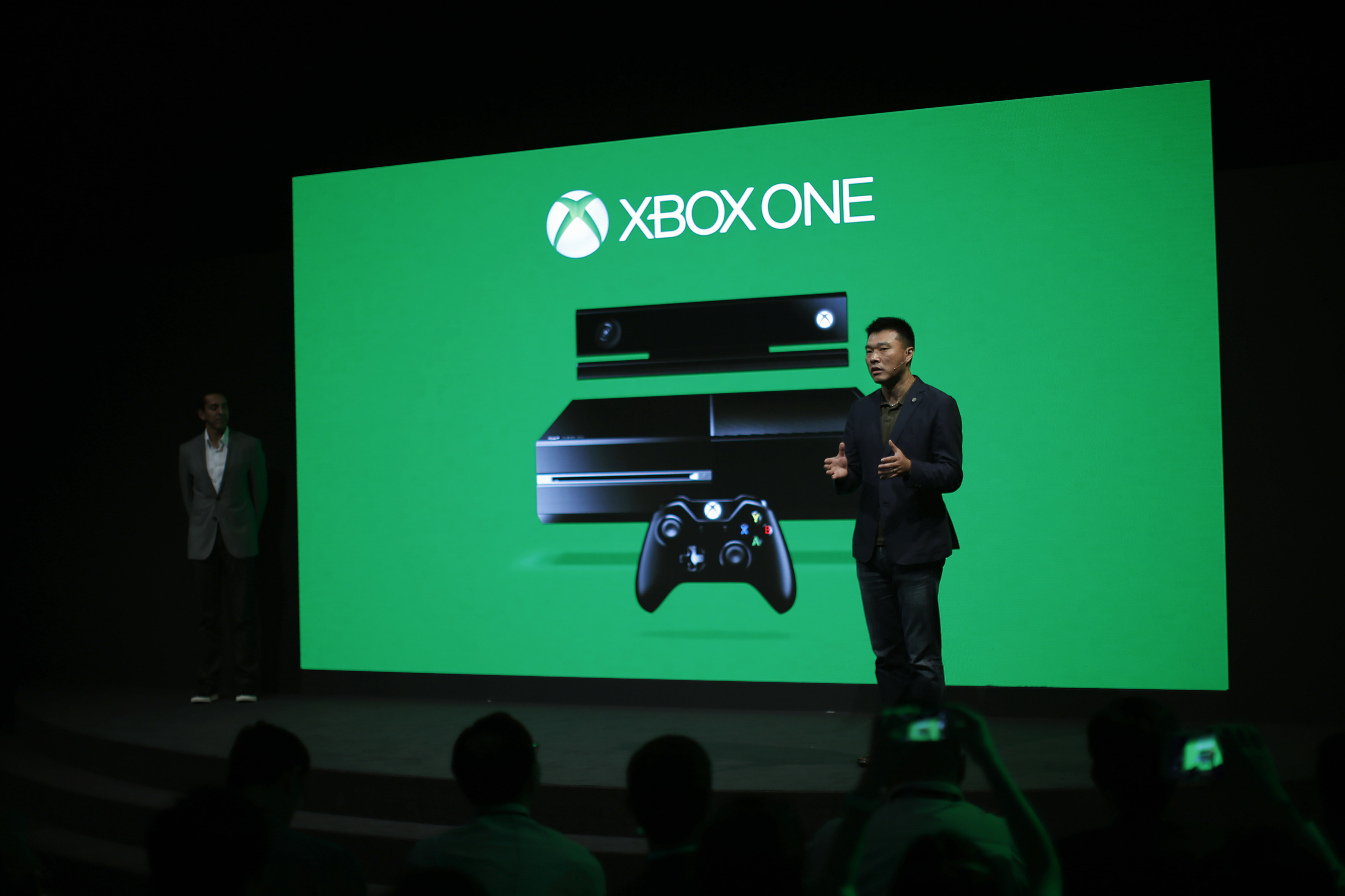 Xie Enwei, general manager of management and operations of Microsoft in China, speaks during the presentation of the Xbox One by Microsoft as part of ChinaJoy 2014 China Digital Entertainment Expo and Conference in Shanghai July 30, 2014. Microsoft Corp will launch its Xbox One gaming console in China on September 23, making it the first foreign company to start selling consoles in the world's third biggest gaming market after a ban on the devices was lifted this year. Microsoft is forging ahead with the console launch despite Tuesday's government announcement that the U.S. software giant is the subject of an anti-monopoly investigation. REUTERS/Carlos Barria (CHINA - Tags: BUSINESS SCIENCE TECHNOLOGY)