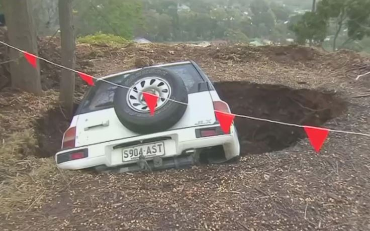 Couple bruised after sinkhole swallows car