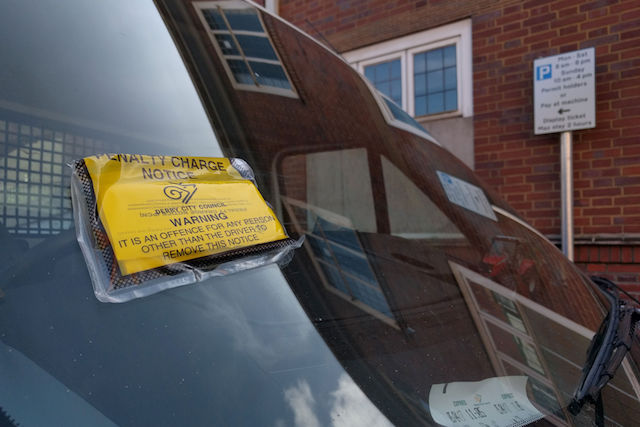 "The parking ticket on the car of Charles Hirons outside Derby Crown Court where he was ordered to pay more than £1,200 after spreading ""muck"" on the steps of same court."