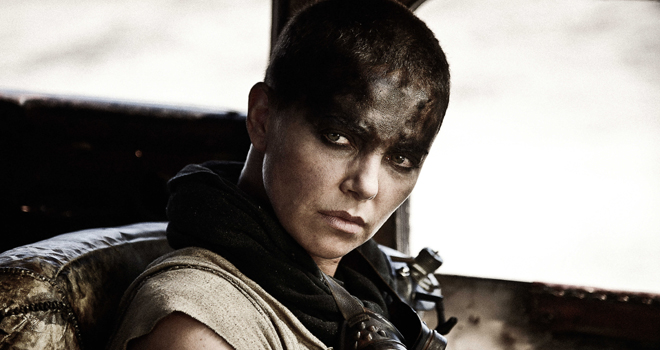 MAD MAX: FURY ROAD - 2015 FILM STILL - CHARLIZE THERON as Furiosa - Photo Credit: Jasin Boland  � 2015 WV FILMS IV LLC AND RATPAC-DUNE ENTERTAINMENT LLC - U.S., CANADA, BAHAMAS & BERMUDA  � 2015 VILLAGE ROADSHOW FILMS (BVI) LIMITED - ALL OTHER TERRITORIES