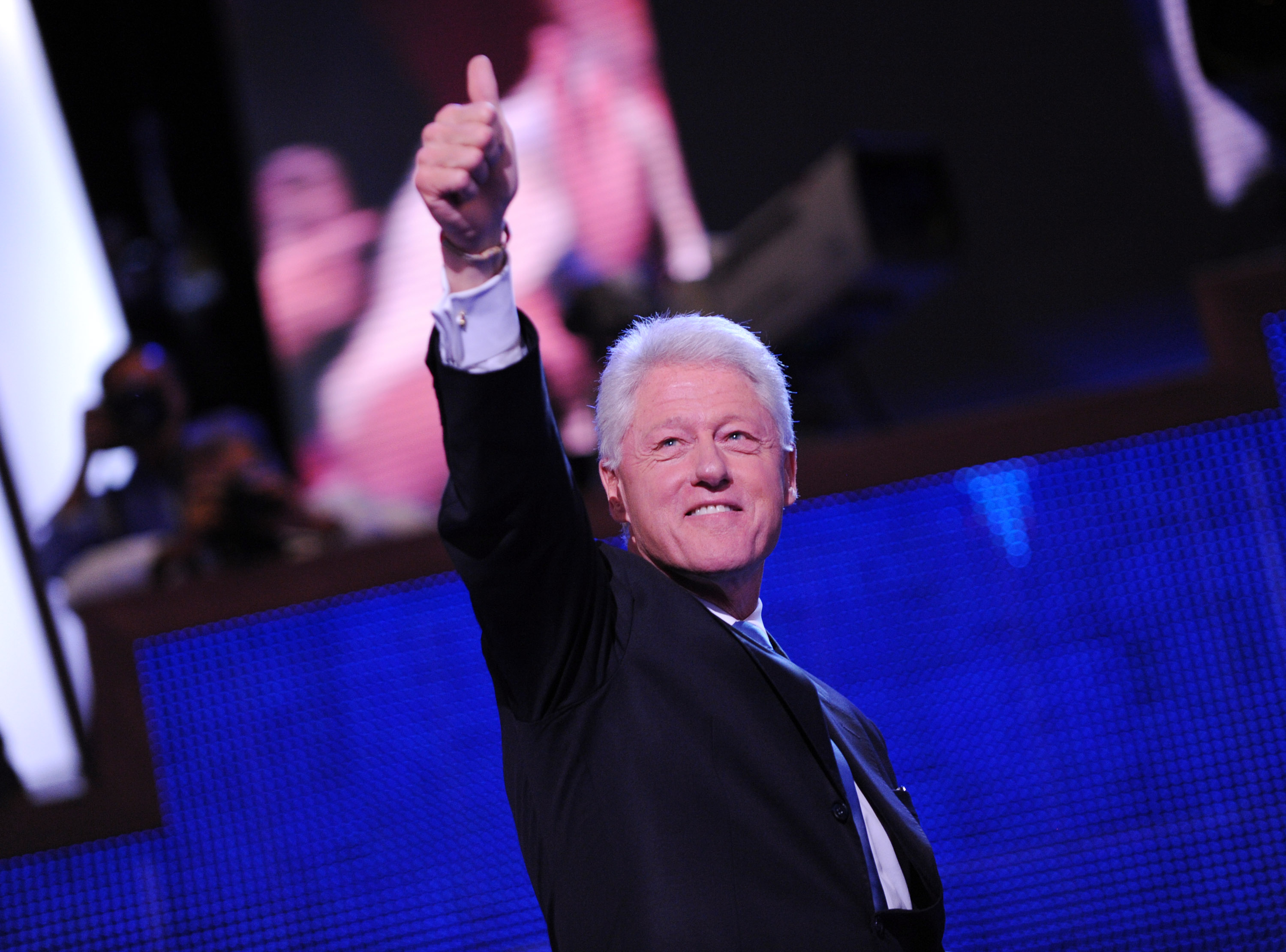 Former President Bill Clinton flashes a thumbs up following