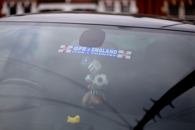 A queens park rangers sticker in a parked car