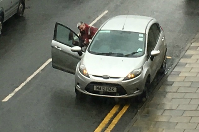 Traffic warden parked on double yellow lines