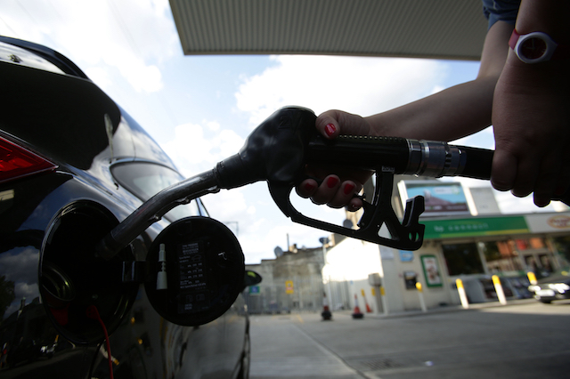 A car being filled up with a pump at a petrol station in London. PRESS ASSOCIATION Photo. Picture date: Sunday August 3, 2014. Photo credit should read: Yui Mok/PA Wire