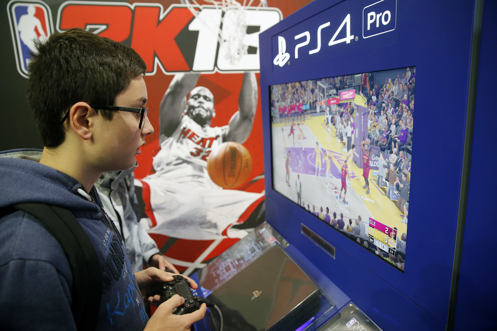 PARIS, FRANCE - NOVEMBER 01:  Gamers play the video game 'NBA 2K18' developed by Visual Concepts and published by 2K Sports on Sony PlayStation game consoles PS4 Pro during the 'Paris Games Week' on November 01, 2017 in Paris, France. 'Paris Games Week' is an international trade fair for video games to be held from October 31 to November 5, 2017.  (Photo by Chesnot/Getty Images)