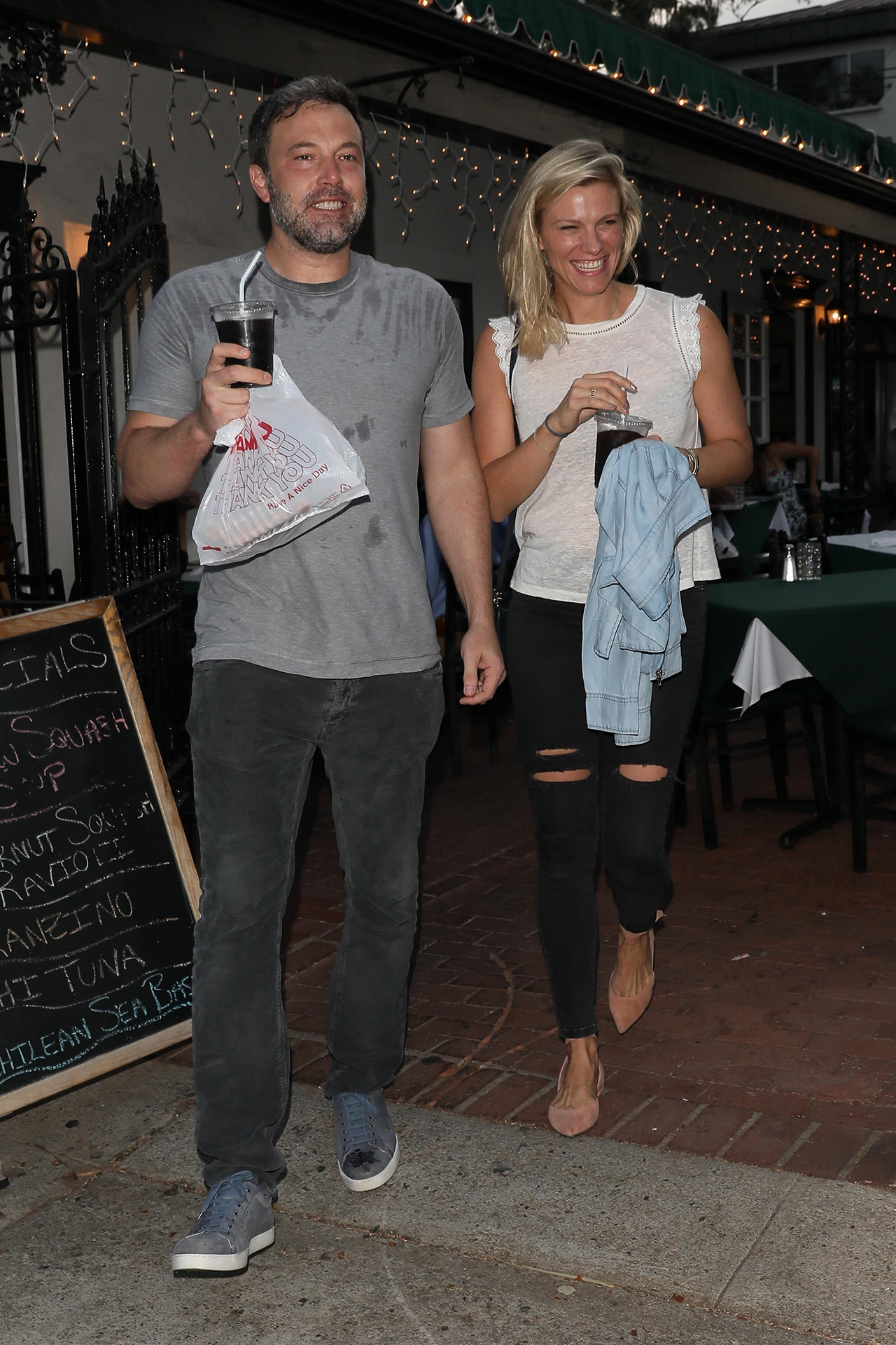Pacific Palisades, CA  - Ben Affleck looks extremely happy exiting Beech Street Cafe restaurant after having some pizza with new girlfriend Lindsay Shookus.  Pictured: Ben Affleck and Lindsay Shookus  BACKGRID USA 10 JULY 2017   BYLINE MUST READ: NGRE / BACKGRID  USA: +1 310 798 9111 / usasales@backgrid.com  UK: +44 208 344 2007 / uksales@backgrid.com  *UK Clients - Pictures Containing Children Please Pixelate Face Prior To Publication*