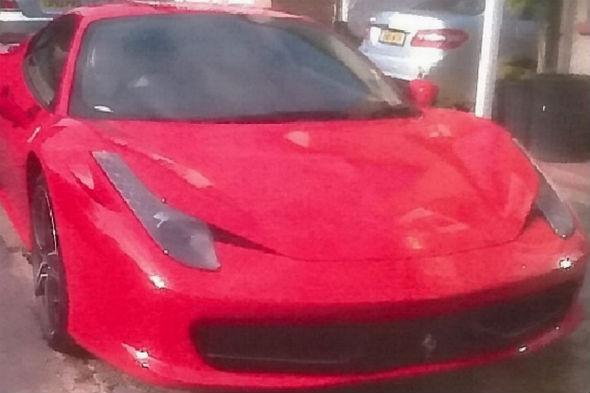Bent cop rumbled after buying Ferrari
