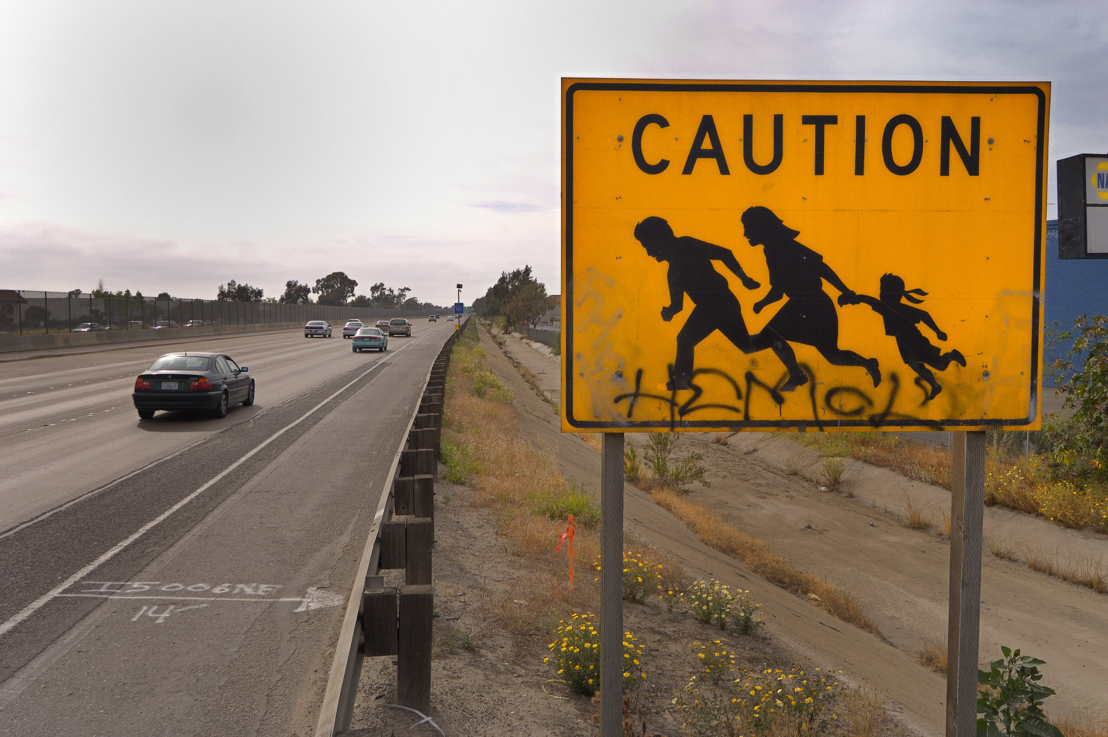 A road sign, along Interstate Highway 5 near San Ysidro, California, warns motorists to watch out for migrant workers crossing the highway. According to the US Border Patrol, 1,954 people died crossing the U.S.-Mexico border illegally between the years 1998-2004. The United States office of Homeland Security has plans to expand border security between the two countries in an attempt to stem the tide of illegal immigrants entering the USA from Mexico. (Photo by Christopher Morris/Corbis via Getty Images)