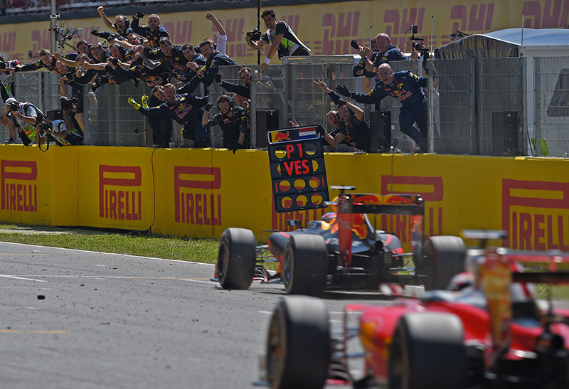 Red Bull's Belgian-Dutch driver Max Verstappen (C) wins ahead of Ferrari's Finnish driver Kimi Raikkonen at the Circuit de Catalunya on May 15, 2016 in Montmelo on the outskirts of Barcelona during the Spanish Formula One Grand Prix.