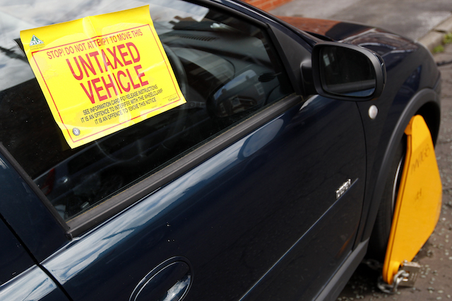 An untaxed car is clamped on a street in Stockport.