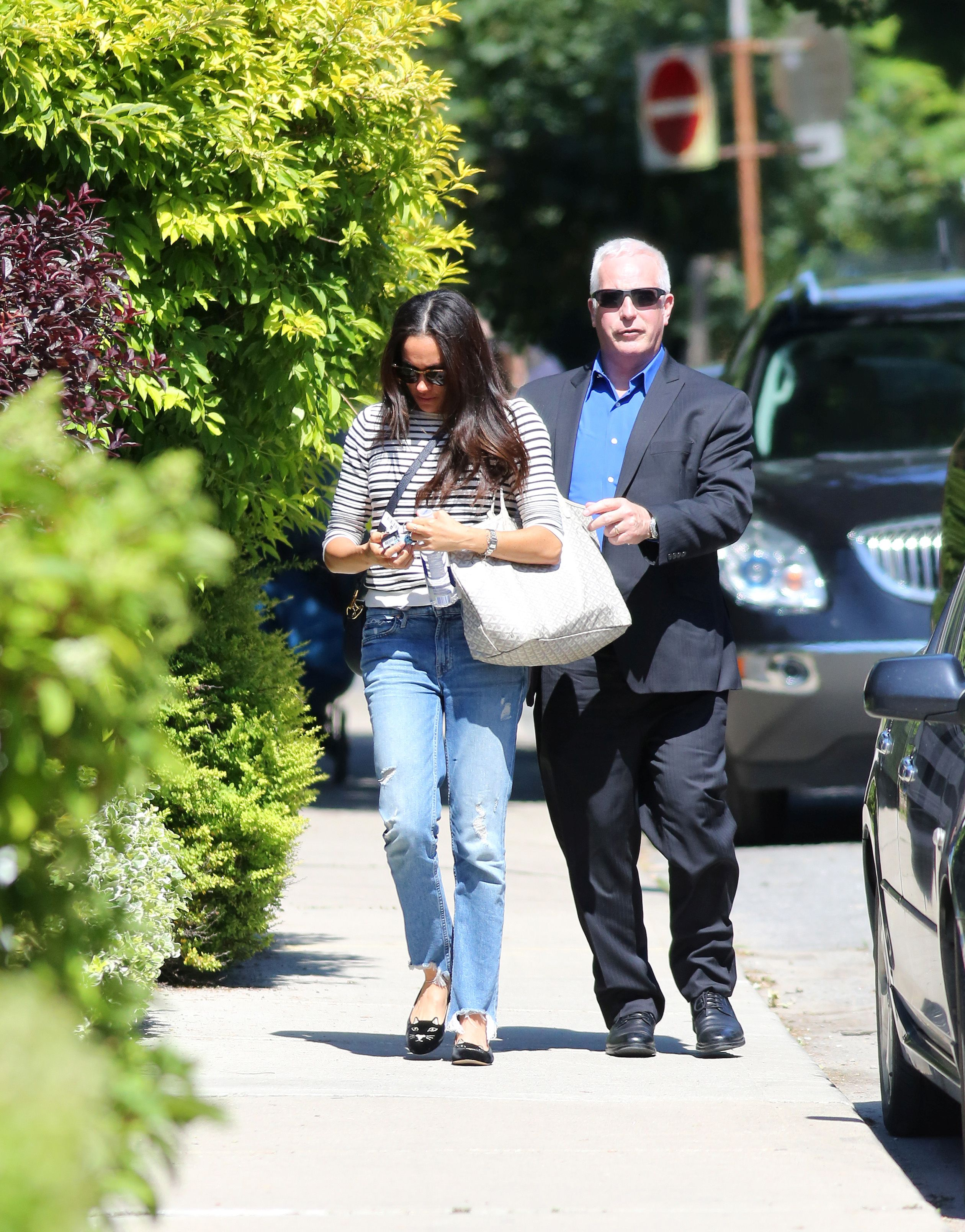 EXCLUSIVE: **PREMIUM EXCLUSIVE RATES, MUST AGREE FEES** Meghan Markle arrives back at her Toronto home after spending ten days in London. As she her arrives home she drops her cell on her security guard foot. Also spotted wearing cat slippers, possibly Kitty Flats sold by Charlotte Olympia retail for US$495. Her SUV was spotted at Toronto International in a high security zone reserved for the highest VIP's. <P> Pictured: Meghan Markle <B>Ref: SPL1495571  060717   EXCLUSIVE</B><BR/> Picture by: Splash News<BR/> </P><P> <B>Splash News and Pictures</B><BR/> Los Angeles:	310-821-2666<BR/> New York:	212-619-2666<BR/> London:	870-934-2666<BR/> photodesk@splashnews.com<BR/> </P>