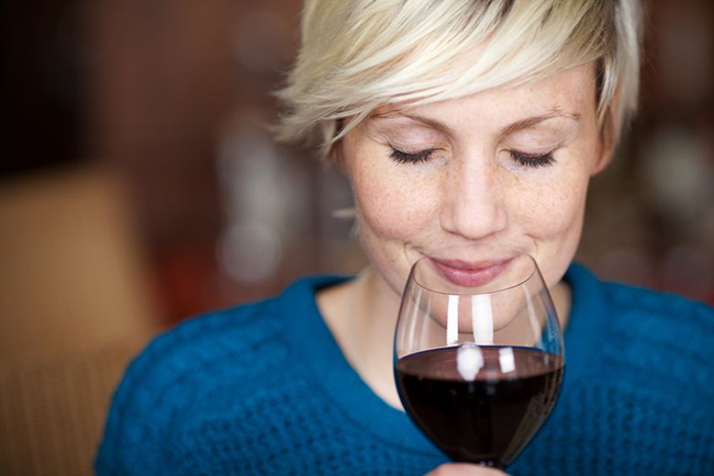 21258879 - closeup portrait of young female customer drinking red wine with eyes
